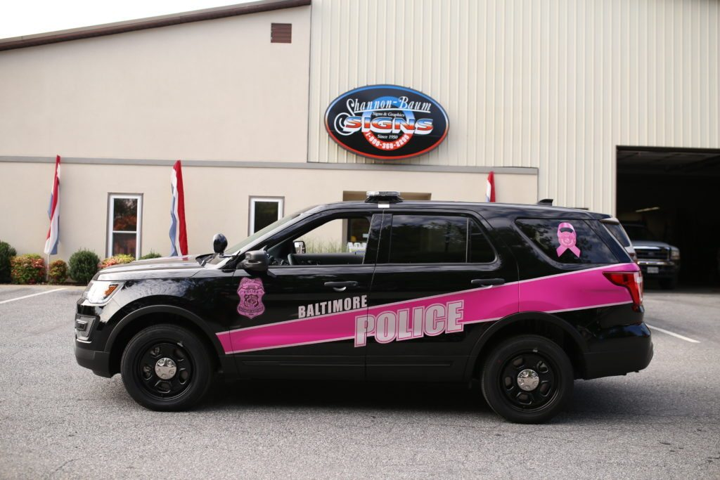 Police Car reflective graphics on a Ford Explorer