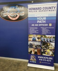 Retractable banner and stand for Howard County Police